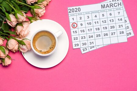 Pink roses, cup of coffee and calendar on bright deep pink background, womens day concept. Top view with copy space, women's day 8 march.