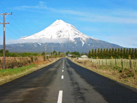 snow capped: road to a snow capped mount egmont, new zealand