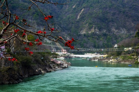 View to Ganga river and lakshman jhula bridge in Rishikesh, India Stock Photo