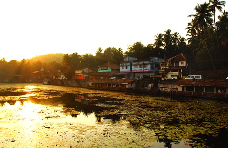 KARNATAKA,INDIA, Coast of sacred lake in Gokarna during sunset Stock Photo