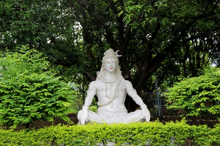 Statue of Hindu Lord Shiva under the tree, Rishikesh. India