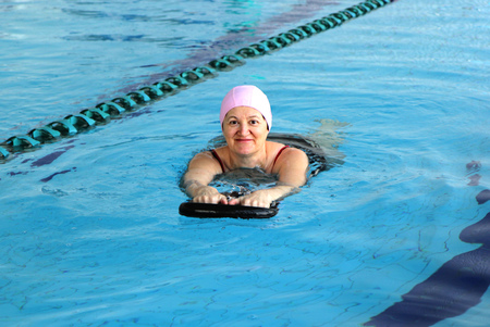 Middle Aged Woman in Swimming Pool