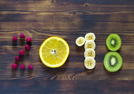 happy new year 2018 of fruit and berries on wooden background Stock fotó