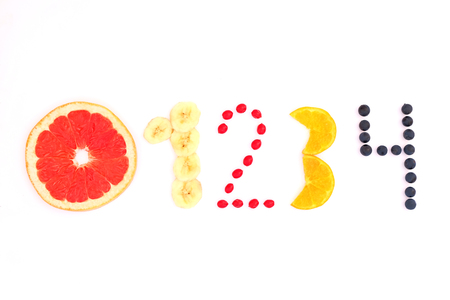 numbers from zero to four made of fruit and berries on white background