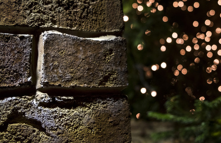 brick wall Christmas background with lights glowing