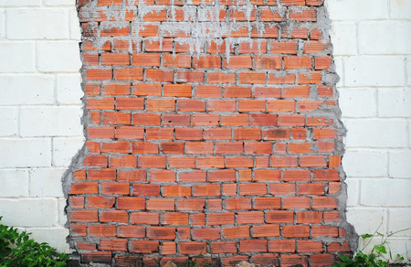 the wall made of red and white brick Stock Photo