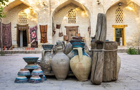 Large earthenware jugs in inner yard of old center of Bukhara, Uzbebkistan