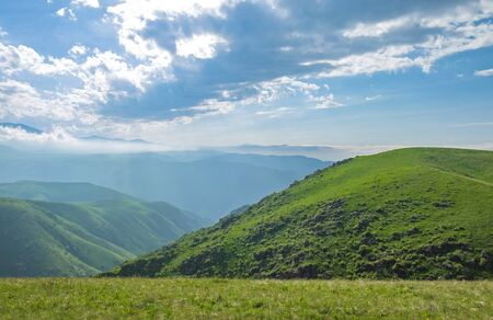 Amazing summer landscape, view to the green hills and beautiful sky.