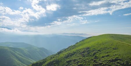 Amazing summer landscape, view to the green hills and beautiful sky