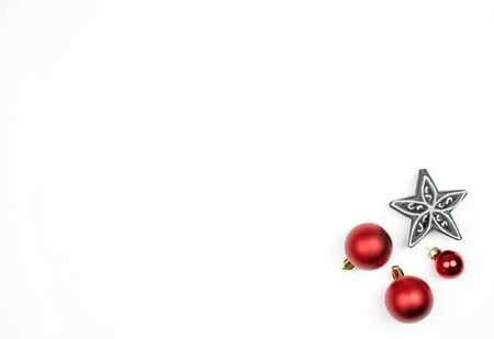 Christmas decoration, red balls and black silver stars on the white background. Flat lay. Copy space. Top view. Stock fotó