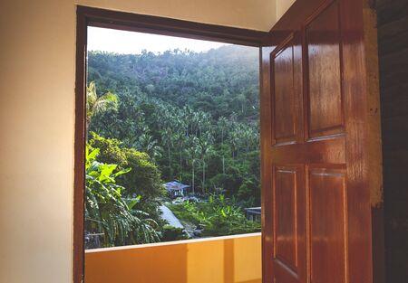 Beautiful tropical view through the open door