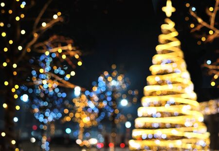Christmas decoration background with golden and blue lights glowing