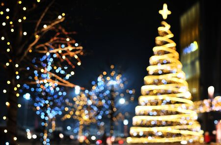 Christmas decoration background with golden and blue lights glowing.