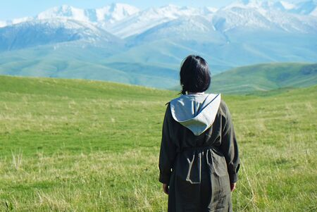Rear view of young woman looking at mountains Stok Fotoğraf