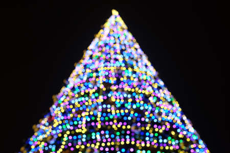 Beautiful christmas tree defocused with lights glowing