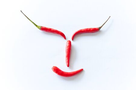 Smiley, Red chili peppers. Isolated on white background.