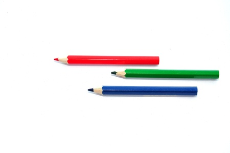 Three colour pencils  isolated on white background