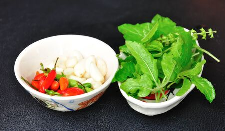 Closeup food ingredient for stir fried hot&spicy, garlic chilli and basil Stock Photo