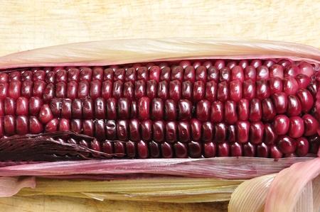 waxy: Purple Waxy Corn on wooden        Stock Photo