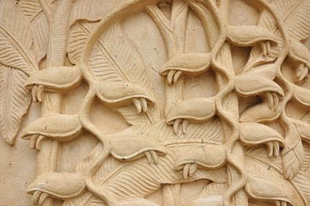 Strelitzia reginae (bird of paradise) stone craft art design for spa photo