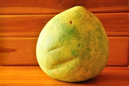 Pummelo on wooden background, Citrus maxima Stock Photo