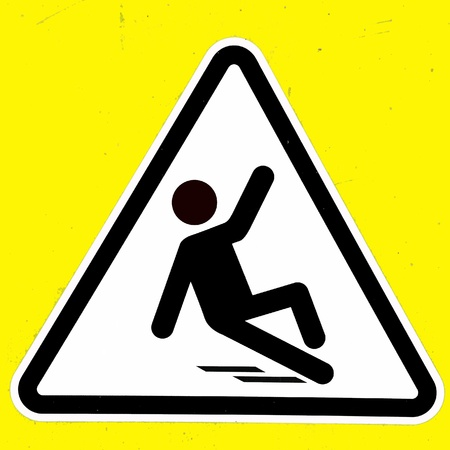 slippery warning symbol: Slippery wet floor sign Stock Photo