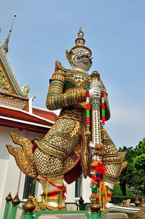 White Demon Guardian at Wat Arun, Bangkok, Thailand  Stock Photo