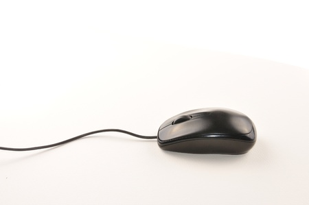 Black computer mouse with cable isolated on white background  photo
