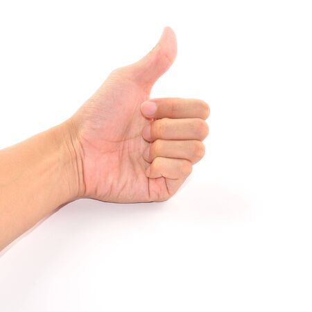 Male hand showing thumbs up sign isolated on white Stock Photo - 13578628