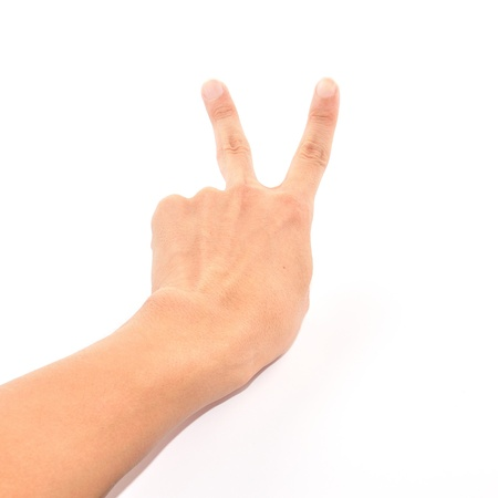 Male hand showing two fingers up isolated on white, peace or victory sign  photo