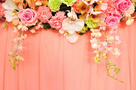 Beautiful flowers blossom on pink curtain background for wedding scene