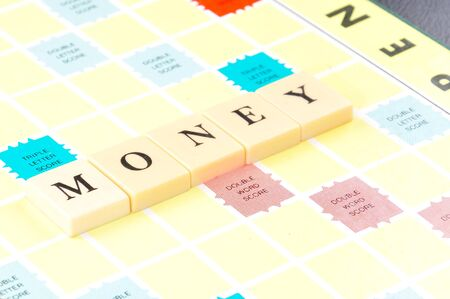Money word on game board, business concept