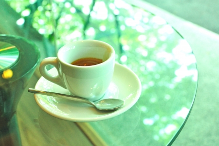 Espresso on glass table, hot coffee Stock Photo
