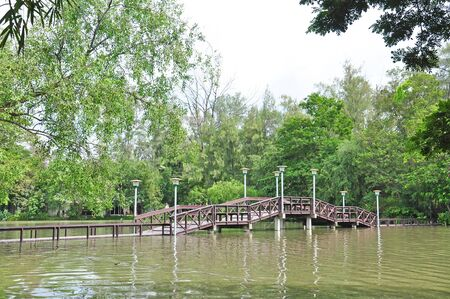 Wooden bridge at Silpakorn university, Nakhon pathom, Thailand photo