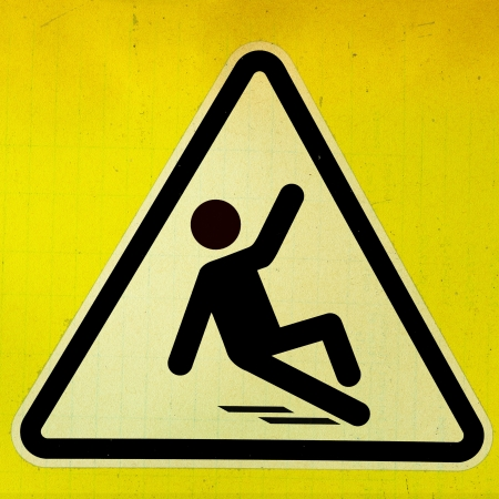slippery warning symbol: Slippery wet floor sign in grunge style