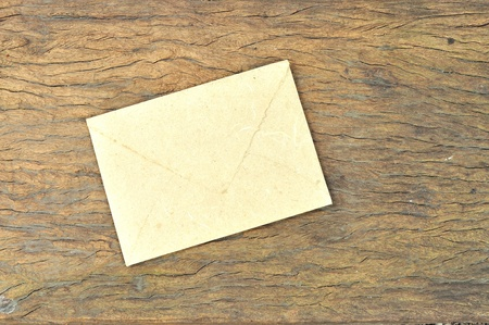 Envelope made by Mulberry paper on wooden texture photo