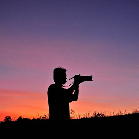 Silhouette of Photographer on the field Stock Photo - 17347024