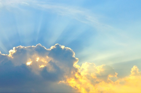 Beautiful cloudscape with sun ray photo