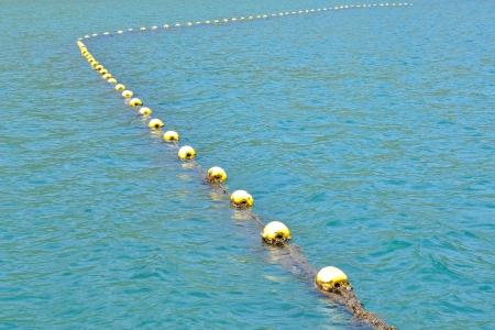 Yellow buoys in the sea photo