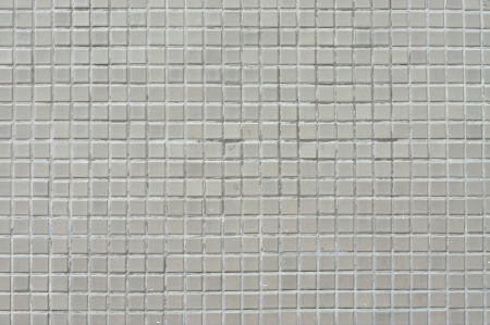 Square tile wall, grunge background  photo