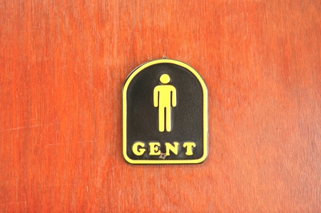 Toilet sign on grunge wooden wall, Men toilet sign  photo