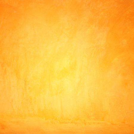 naranja: La pared del grunge amarillo para la textura de fondo