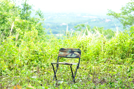 Outdoor folding chair in forest campsite, Camping chair