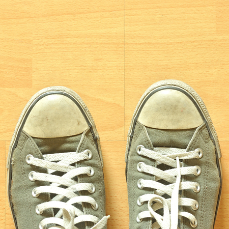 A pair of sneakers on wooden surface photo