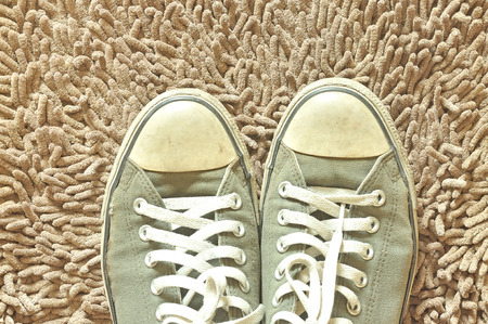A pair of sneakers on beige carpet photo
