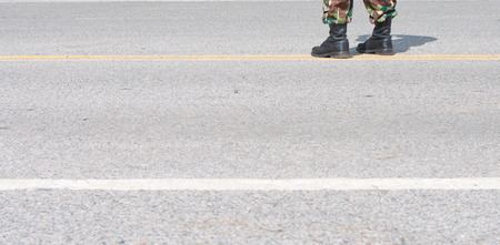 fatigues: Soldier standing on street