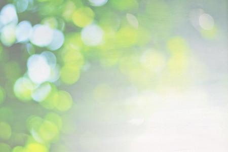 Zielony charakter bokeh na tle płótnie, pastelowe tło
