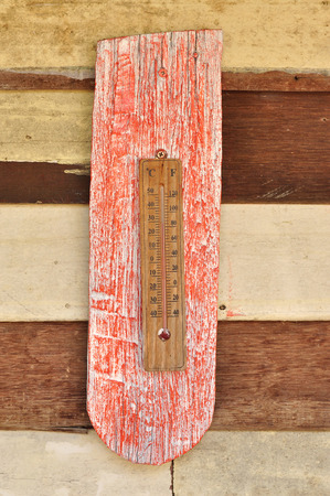 old mercury: Thermometer on grunge wood background Stock Photo