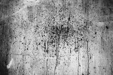 Dirty splash on grunge wall in black and white for texture background