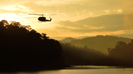 Silhouette helicopter and forest landscape at Bang Lang National Park, Thailand Imagens